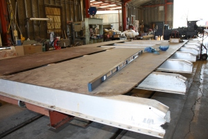 Platforn in shop laid out with steel for cistern bottom.