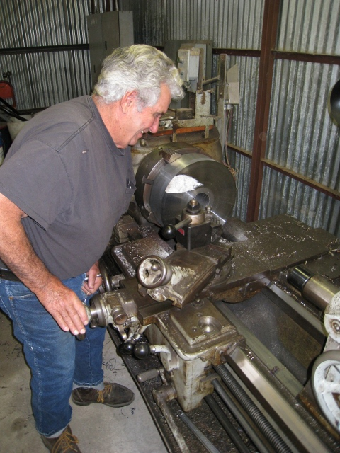 "Bob West machining centerplate on 16"" Axelson lathe in the Tri-Dam shop at Railtown."