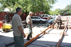Staff get to work laying out the transfer rails to the trailer.