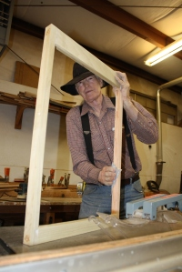 Volunteer Gary Hosman putting finishing touches on new window frame for the Caboose #7 restoration.