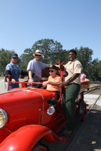 Railtown's new UC Merced intern gets a lift on the Railroad Museum's Fire Truck with the crew.