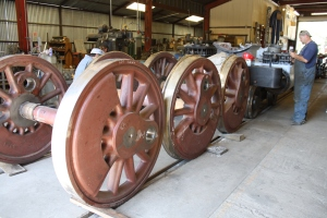 The driving wheels sit in the warehouse, ready to go.