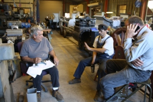 Machinist Bob West, Erik Young and George Sapp compare numbers on the crankpins one more time.