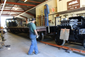 Brakeman Erik Young signals to engineer George Sapp as the frame is shoved onto the trailer.