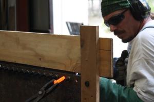 DJ (Dennis Ponder), accepting a rivet.