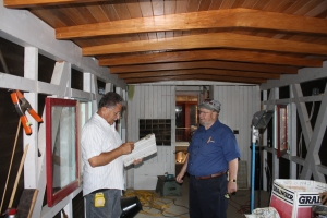 Marty Gerbasi and Cliff Hughes working on the interior of the caboose.