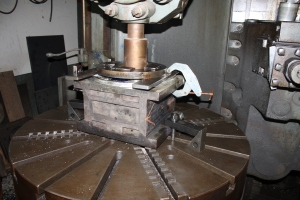 The unit is then mounted into a custom set up to be machined. The crown brass is being machined here.