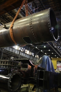 The crane lowers the boiler over the cylinder saddle to check the fit of the smokebox hole.