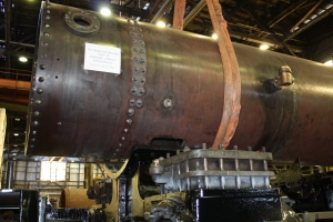 With the rivets taken care of, the boiler is lowered into place.