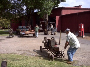 Members of the Early Day Gas Engine and Tractor Association set up Friday afternoon.
