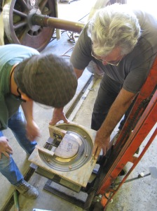Erik Young and Bob West load up the first driving box for machining.