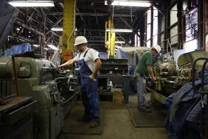 Don Shapiro and Leonard Jones producing bolts on the lathes.