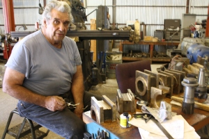 Bob West is working on the rod brass.