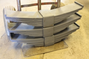 Newly manufactured leaf springs ready to paint and install.