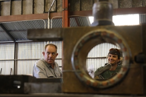 Previously repaired rod brass frames George Sapp and Erik Young at the Jamestown Shop.