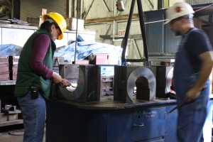 Lisa Smithson and Don Shapiro scrape the bearing surfaces of the driving boxes in preparation for the final fit.