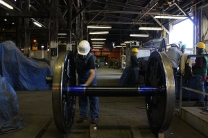 Don Shapiro applies machinist's blue dye to the axles of the driving wheels for testing of the driving boxes.