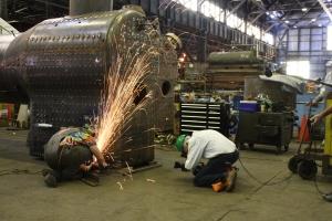 """Dennis """"DJ"""" Ponder grinds down the proud rivets on the boiler."""