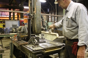 George Sapp cuts stock for bolts at the end of the day, foreshadowing Monday's activities.