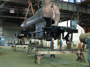 The boiler and chassis were lifted off of the horses by overhead crane.