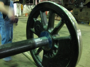 Grease was applied to the axle and driving wheel in preparation for the boxes.