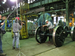 The boxes were then lifted into place on the axles of the driving wheels.