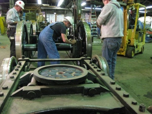 Graphite cakes are applied to the pilot truck center plate.