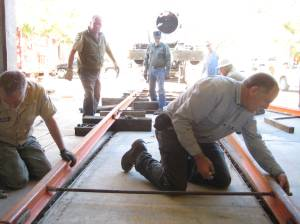 With the truck, and front of the trailer removed, the crew laid out the track ramp for remove of the locomotive.