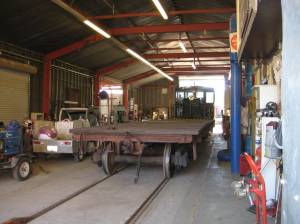 George then drove the diesel and a flatbed car through the shop.