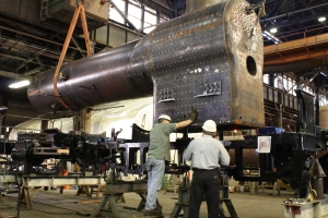 Greg Kelsch and George Sapp guide the boiler in for the final time.