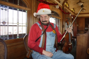 "Fiddler Dave ""Huckleberry"" Rainwater is a holiday tradition in his own right!"