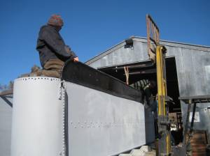 DJ and Rob wiggle the coal board into place for rivetting.