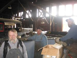 The crew waits for the next batch of rivets to heat.