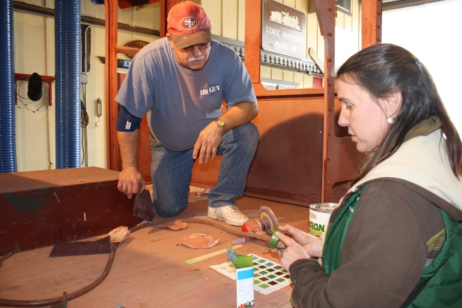 Volunteer painter Mike Warzee and Curator Lisa Smithson confirm paint color for the cab interior