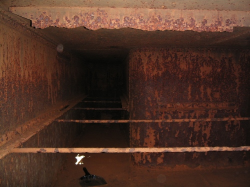 Interior of the old tender water cistern.  White spot is hole caused by corrosion, which also caused extensive thinning throughout the tank.