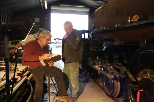 Bob West and Rob Buchanan review numbers for crosshead guide measurements for a final time.