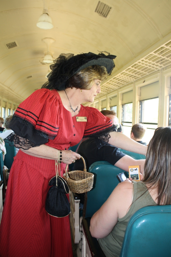 Volunteer Shirley hands out seed packets on the train.