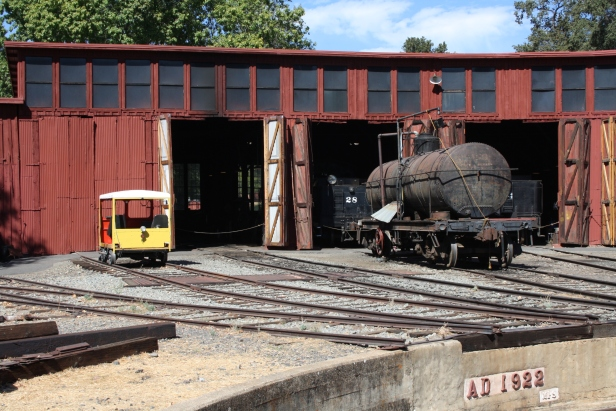 Track car and tank car at roundhouse
