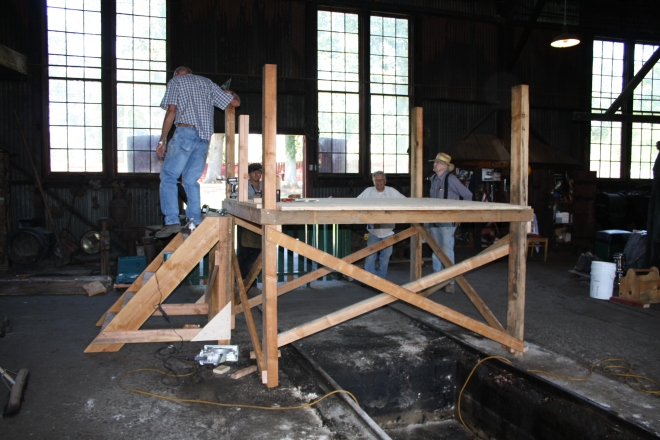 In the meantime. . .other volunteers were working on the construction of the work scaffolding