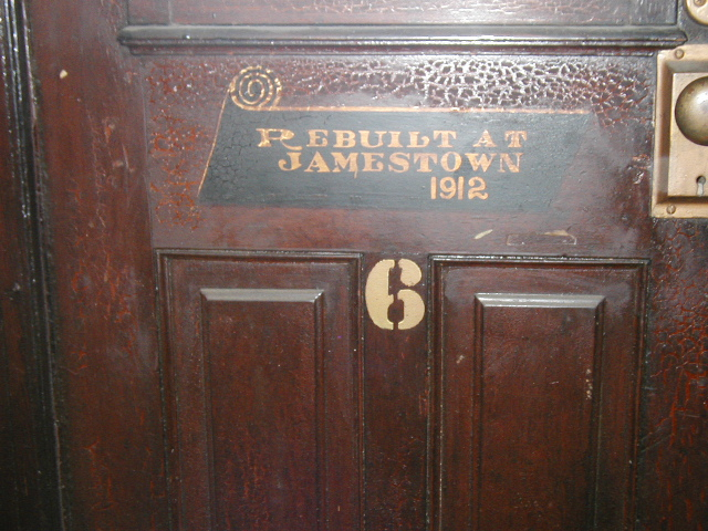 """Placard in Coach No. 6, """"Rebuilt at Jamestown, 1912."""" This was following the crash of 1905."""