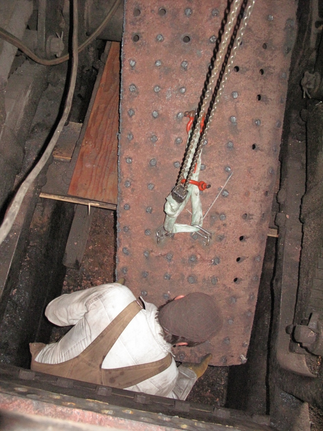 The piece was lowered through the firebox and removed from underneath.