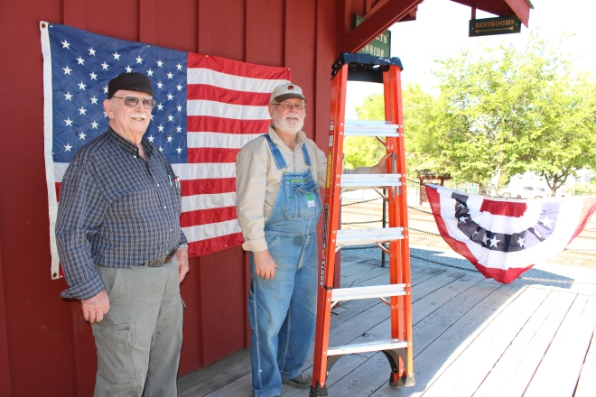 Volunteers Bill & Bob decorating for the 4th.