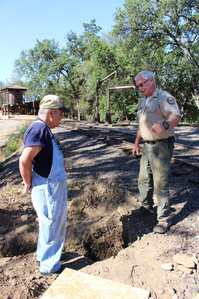 Volunteer Hal and Park Maintenance Worker Rob- working on a broken water pipe.