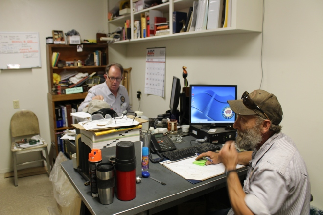 Railroad Restoration Lead Worker George and Senior Maintenance Aide Phil getting some office work done