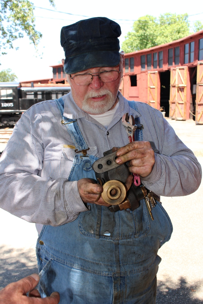 Volunteer David working on valve repairs for the No. 3