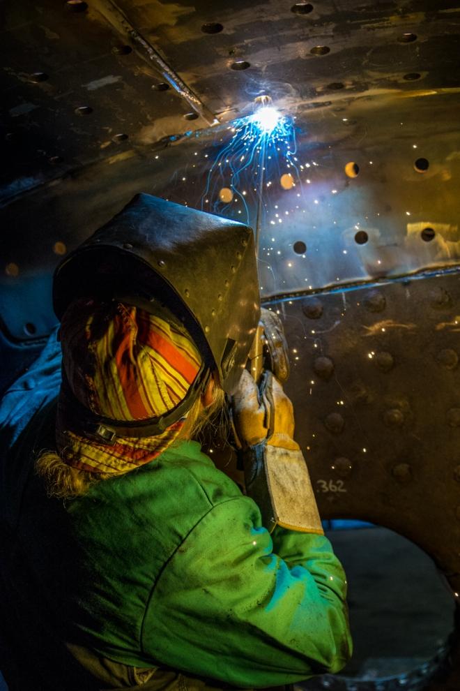 Greg Nelson welding the seem between the firebox knuckle and crown sheet.
