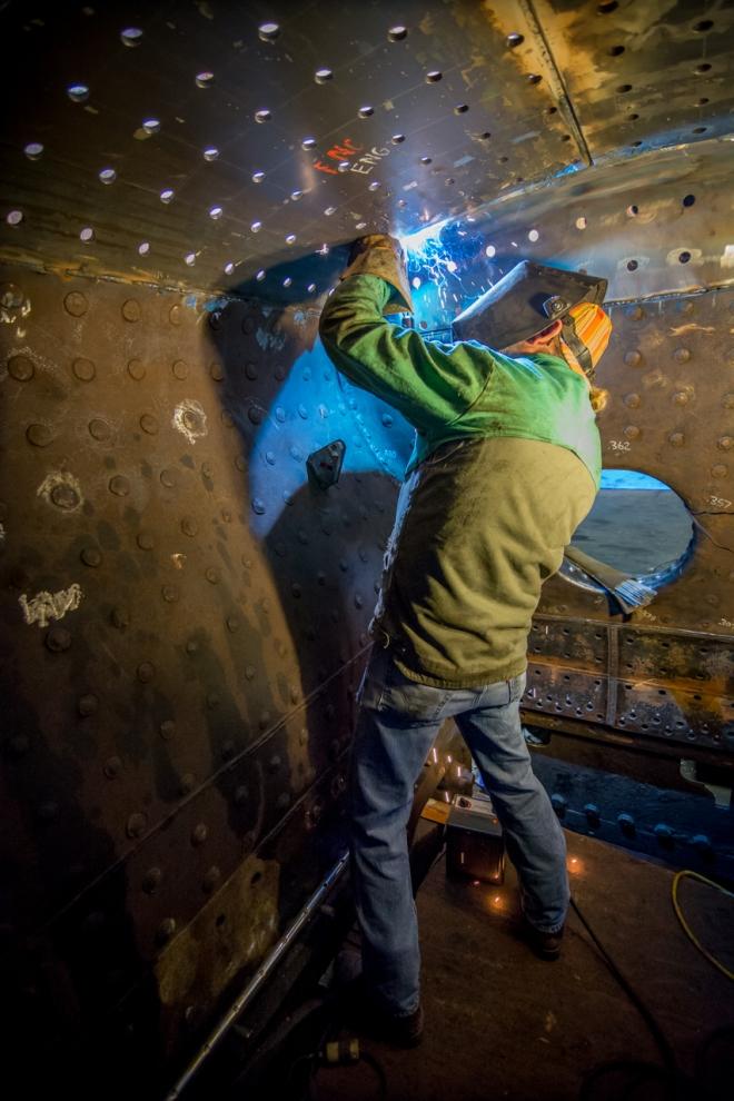 Greg Nelson welding inside the firebox.